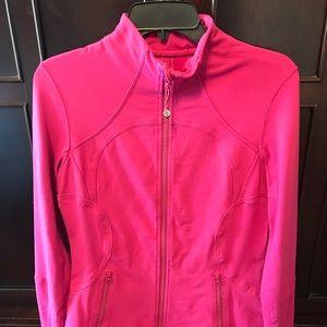 Lululemon define or contour jacket in pink.